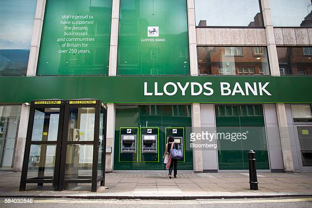 A customer uses an automated teller machine outside a Lloyds Bank branch a unit of Lloyds Banking Group Plc on Oxford Street in London UK on Thursday...
