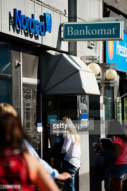 A customer uses an automated teller machine outside a Nordea Bank AB branch in Gothenburg Sweden on Friday Sept 6 2013 Scandinavia's biggest banks...