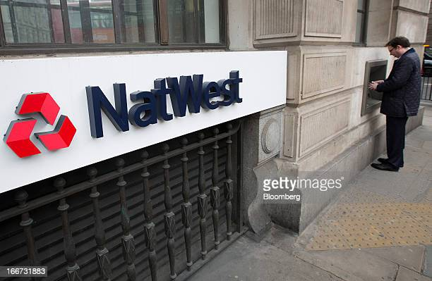 A customer uses an automated teller machine outside of a NatWest bank branch part of the Royal Bank of Scotland Group Plc in London UK on Tuesday...