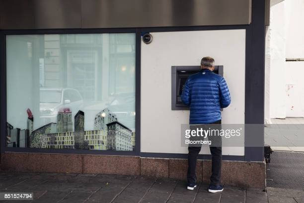 A customer uses an automated teller machine outside outside a Nordea Bank AB bank branch in Oslo Norway on Friday Sept 22 2017 Norways sovereign...