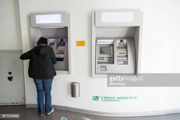 Customer uses an automatic teller machine at a branch of Credit Agricole SA's Cariparma bank in Rome, Italy, on Tuesday, May 2, 2017. Cariparma is in...
