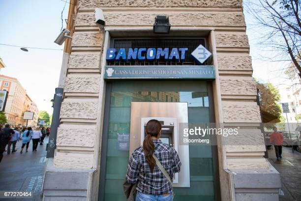 Customer uses an automatic teller machine at a Cassa di Risparmio di San Miniato SpA bank branch in Rome, Italy, on Tuesday, May 2, 2017. Credit...