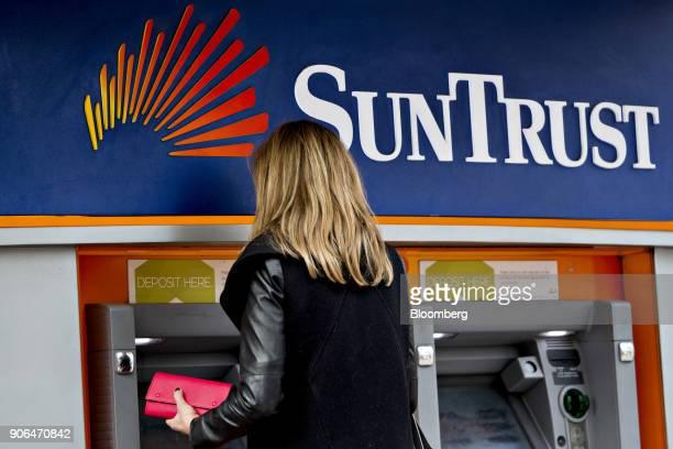 A customer uses an automatic teller machine at a SunTrust Banks Inc branch in Washington DC US on Thursday Jan 11 2018 SunTrust Banks Inc is...