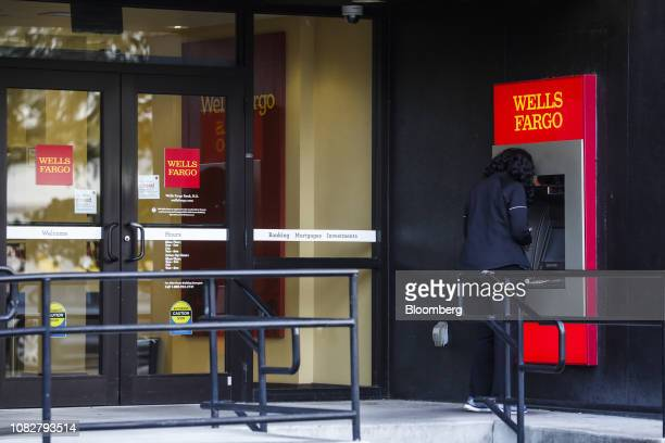A Customer Uses An Automatic Teller Machine At Wells Fargo Co Bank Branch In St