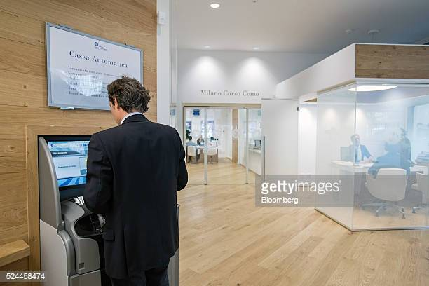 A customer uses an automatic teller machine inside a Banca Popolare di Vicenza SpA bank branch in Milan Italy on Tuesday April 26 2016 Popolare di...