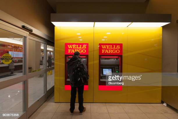A customer uses an automatic teller machine inside a Wells Fargo Co bank branch in New York US on Tuesday Jan 9 2018 Wells Fargo Co is scheduled to...