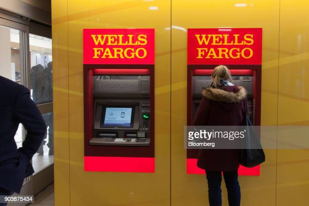 A customer uses an automatic teller machine inside a Wells Fargo Co bank branch in New York US on Friday Jan 5 2018 Wells Fargo Co is scheduled to...