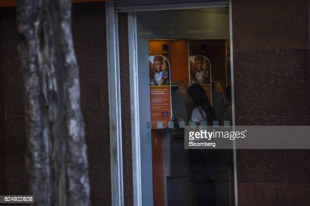 A customer uses an automatic teller machine inside an Itau Unibanco SA bank branch in Rio de Janeiro Brazil on Monday July 31 2017 Itau Unibanco SA...