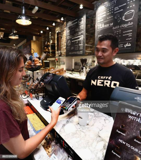 A customer uses Apple Pay to purchase coffee at Caffe Nero in The Dubai Mall on October 22 2017 in Dubai United Arab Emirates