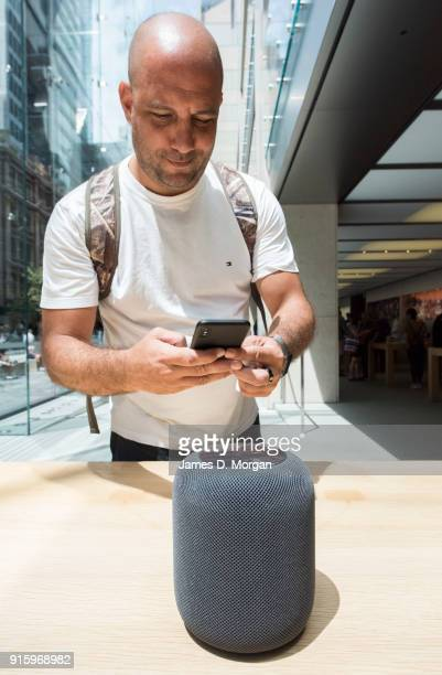 A customer uses his iphone to photograph the new HomePod during the launch of the HomePod at the Apple Store on February 9 2018 in Sydney Australia...