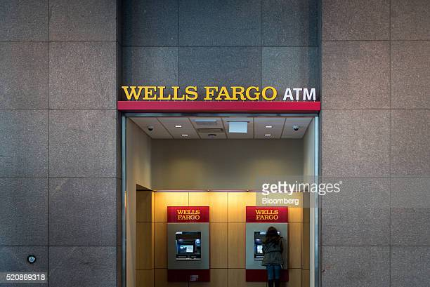 A customer uses the automated teller machine at a Wells Fargo Co bank branch in Chicago Illinois US on Saturday April 9 2016 Wells Fargo Co is...