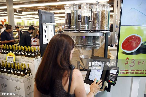 A customer uses the teaBOT automated loose leaf tea machine on the opening day of the 365 by Whole Foods Market store in the Silver Lake neighborhood...