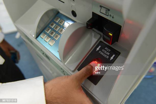 A customer using Aadhaar Biometric enabled ATM on June 13 2016 in Bengaluru India Cash withdrawal and other transaction made possible by simply using...