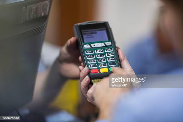 Customer using credit card reader at store