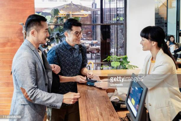customer using mobile payments - visual china group stock pictures, royalty-free photos & images