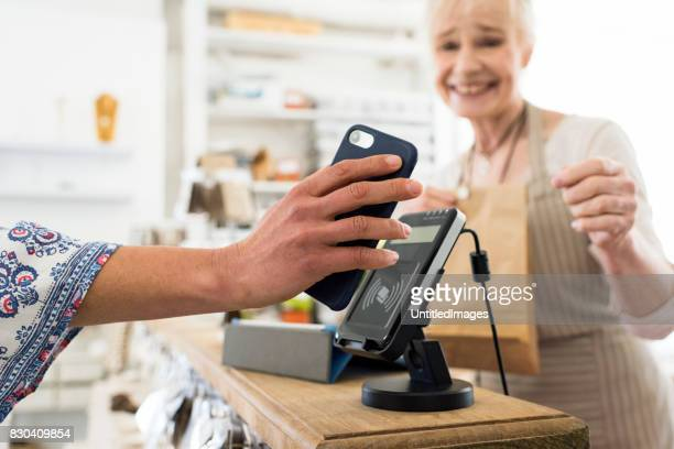 Customer using wireless payment to purchase