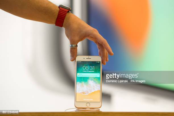 A customer views a new iPhone 8 Plus at the Apple Store on Regent Street London as the iPhone 8 and iPhone 8 Plus go onsale in the UK