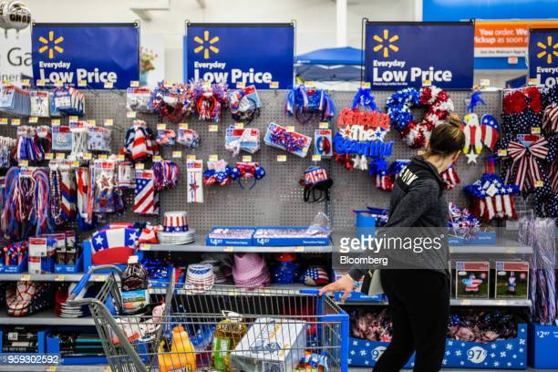 A customer views American flag themed decorations for sale at a Walmart Inc store in Secaucus New Jersey US on Wednesday May 16 2018 Walmart is...