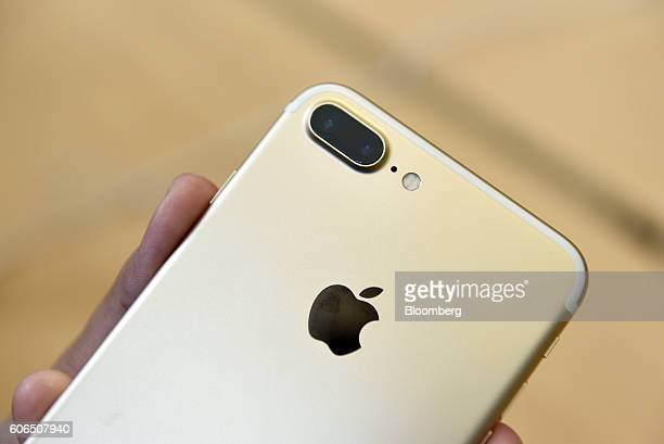A customer views an iPhone 7 Plus smartphone at an Apple Inc in San Francisco California US on Friday Sept 16 2016 Shoppers looking to buy Apple...