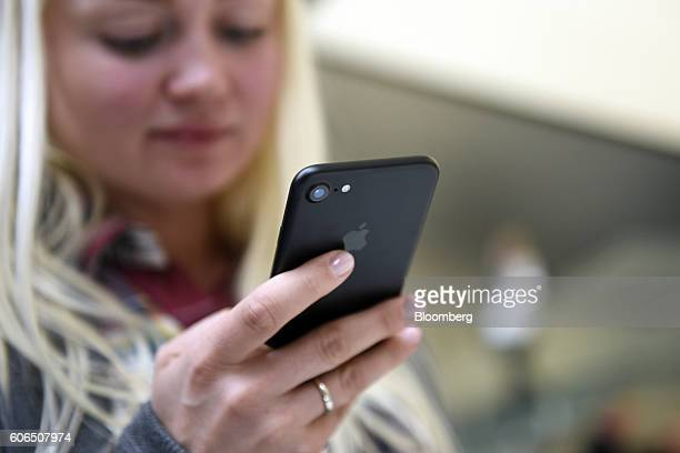 A customer views an iPhone 7 smartphone at an Apple Inc in San Francisco California US on Friday Sept 16 2016 Shoppers looking to buy Apple Inc's new...