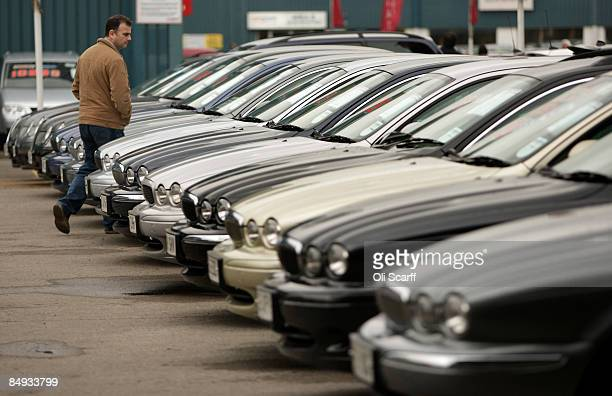 A customer views the cars on sale at Cargiant the world's largest car supermarket in White City on February 18 2009 in London The Cargiant site on...