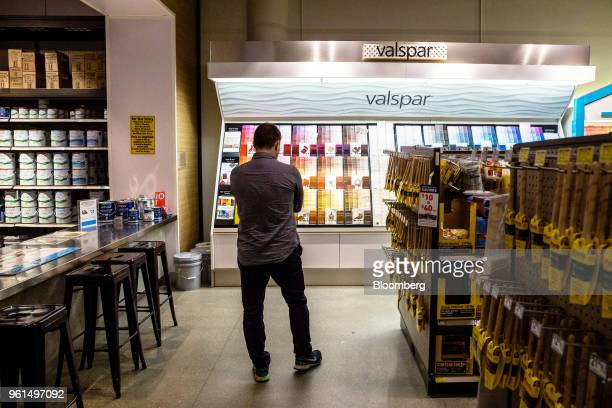 A customer views Valspar Corp paint swatches on display at a Lowe's Cos store in New York US on Tuesday May 22 2018 Lowe's Cos is scheduled to...