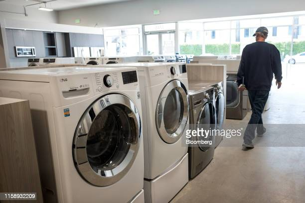 A customer views washing machines displayed for sale at the Airport Home Appliance store in Redwood City California US on Tuesday July 30 201 The US...