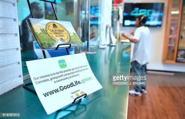 A customer waits as his order of medical marijuana is filled at Virgil Grant's dispensary in Los Angeles California on February 8 2018 Virgil Grant...