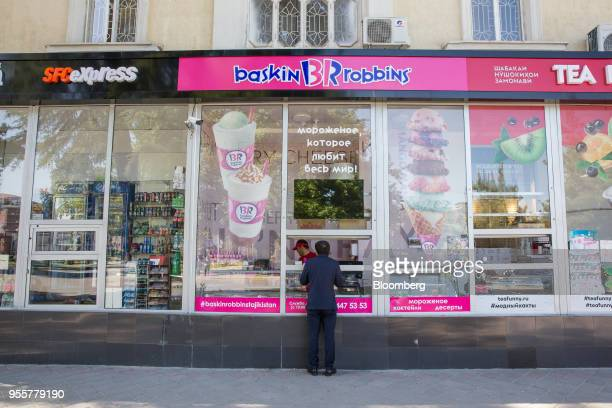 A customer waits at the service window to a Baskin Robbins store operated by Dunkin' Brands Group Inc in Dushanbe Tajikistan on Saturday April 21...