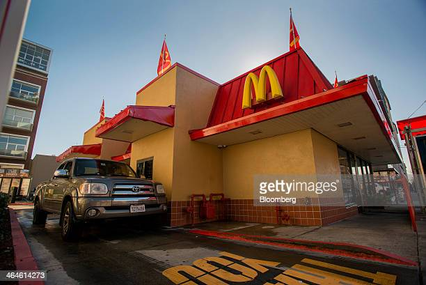A customer waits for an order at the drivethru of a McDonald's Corp restaurant in San Pablo California US on Wednesday Jan 22 2014 McDonald's Corp...