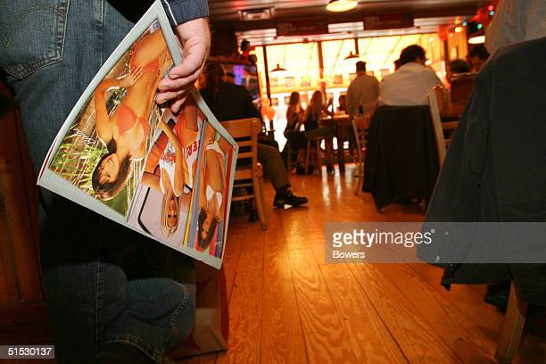 Customer waits in line at a Hooters girls calendar signing event at Hooters restaurant October 21, 2004 in New York City.