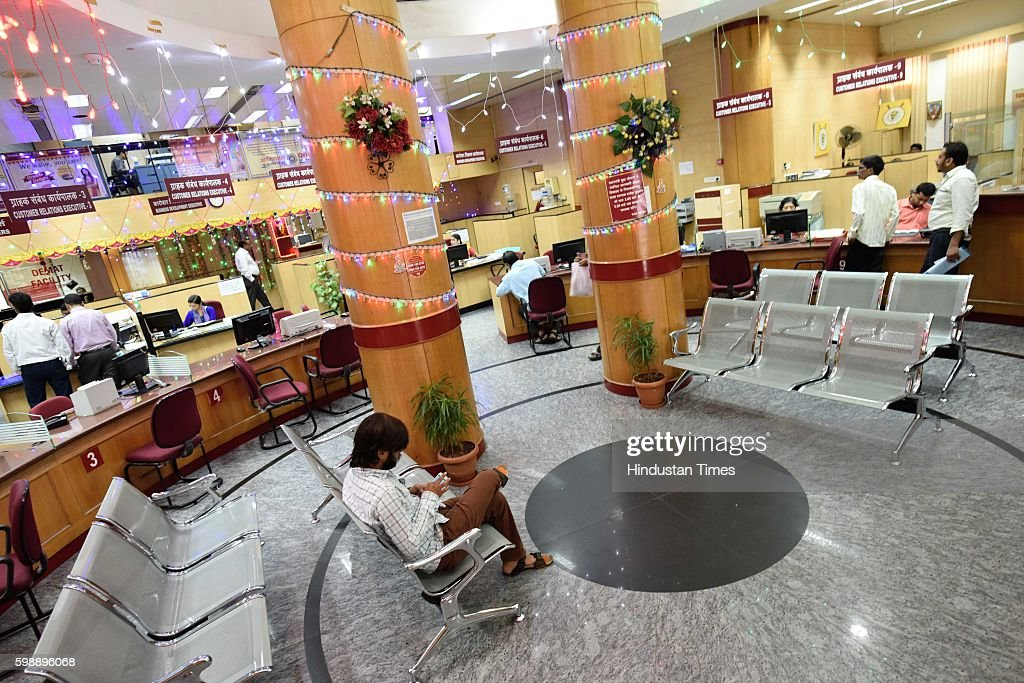 A customer waits inside an empty branch of Punjab National Bank as several trade unions call strike against Central Government at Azad Maidan on...