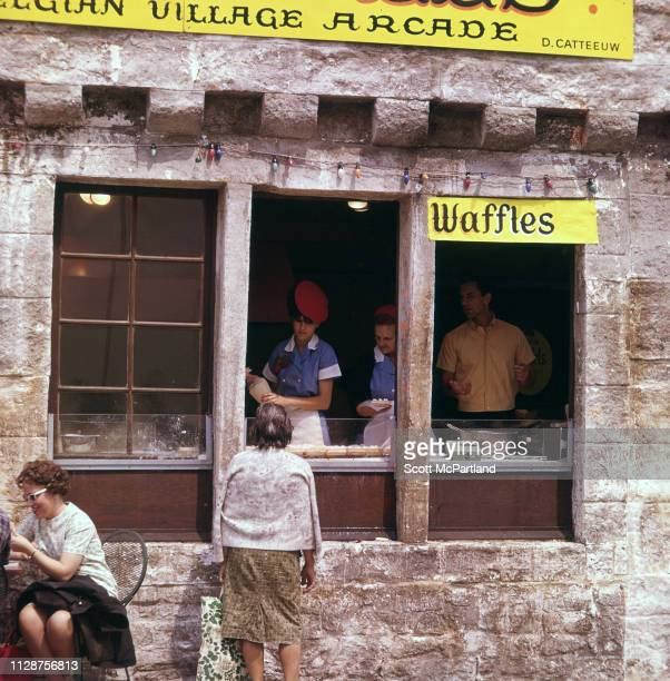 Customer waits outside a waffle stand in the Belgian Village during the World's Fair in Queens, New York, New York, June 1965.