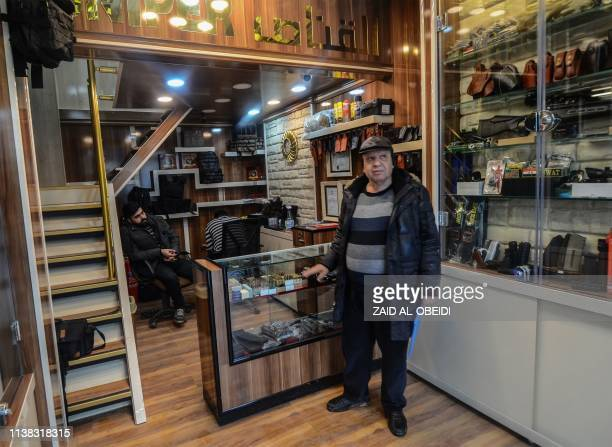 A customer waits to be served in a gun shop in the northern Iraqi city of Mosul on January 28 2019 Hunting rifles pistols and towers of ammunition...
