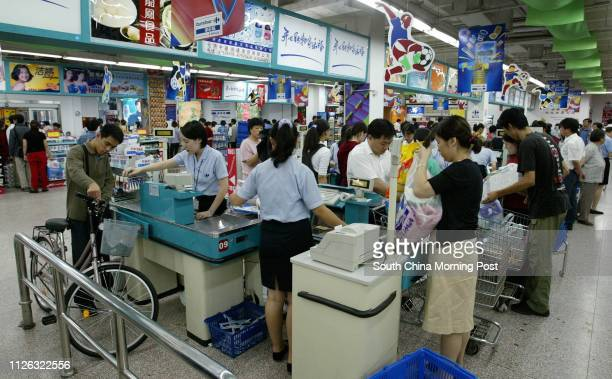 A customer waits to buy a bicycle at the French owned Carrefour Department store in Beijing China The store has 3 branches in the city and has...