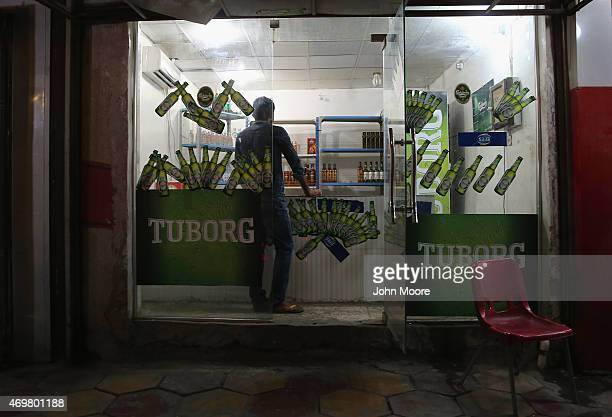 A customer waits to buy beer at a shop on April 14 2015 in Baghdad Iraq Nightlife has returned to Baghdad following the February lifting of the...