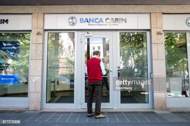 Customer waits to enter a Banca Carim Cassa di Risparmio di Rimini SpA bank branch in Rome, Italy, on Tuesday, May 2, 2017. Credit Agricole SA's...