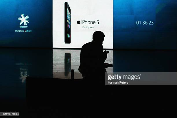 A customer waits to purchase his new iPhone 5 on September 27 2012 in Auckland New Zealand Telecom with help of rugby great Jonah Lomu launched the...