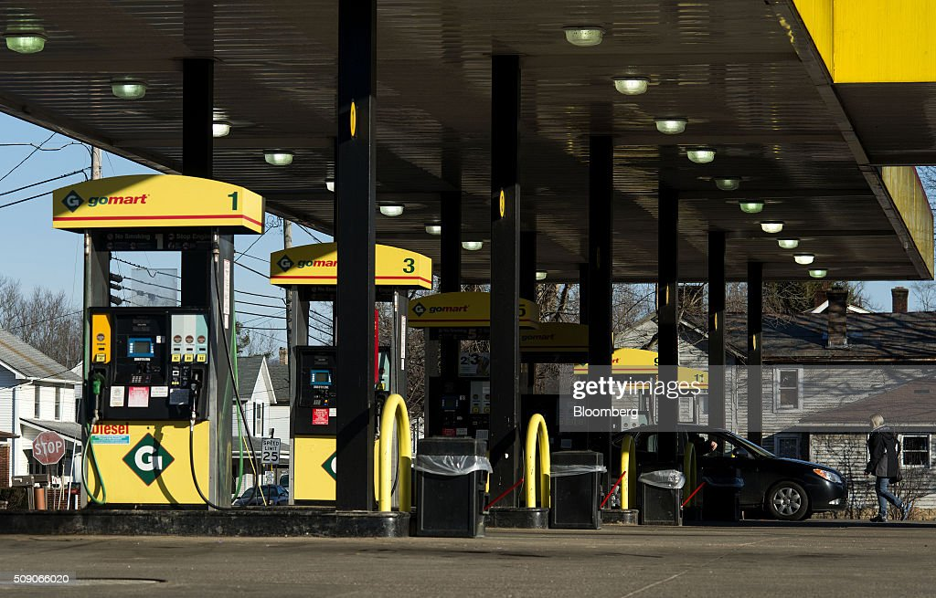 A customer walks back to a vehicle after paying for fuel at a Go Mart Inc. gas station in Rockbridge, Ohio, U.S., on Saturday, Feb. 6, 2016. Thanks to a glut of oil that has spurred refiners to make as much fuel as they can, pump prices nationwide are down about 26 cents a gallon from a year ago, which is translating into almost $80 million a day in savings for U.S. drivers, according to Michael Green, a spokesman in Washington for AAA. Photographer: Ty Wright/Bloomberg via Getty Images