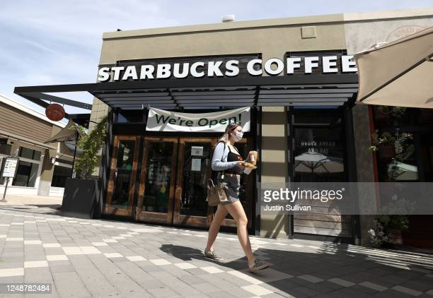 Customer walks by a Starbucks Coffee store on June 10, 2020 in Corte Madera, California. Starbucks announced plans to close 400 of its company owned...
