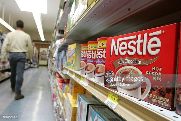 A Customer walks by Nestle products on a store shelf February 23 2006 in San Francisco California Profit for Nestle the world's biggest food and...