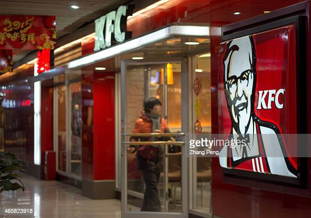 A customer walks into a KFC restaurant KFC restaurants in China will start selling freshly ground coffee in 2015 to become a lowercost premium...