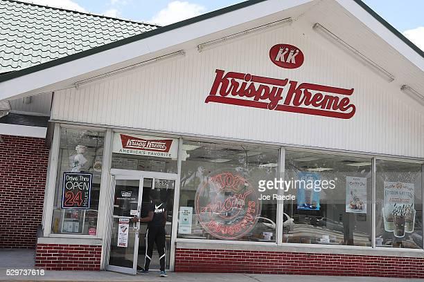 Customer walks into a Krispy Kreme donut shop on May 09, 2016 in Miami, Florida. JAB Holdings Company, announced it is acquiring Krispy Kreme Donuts...