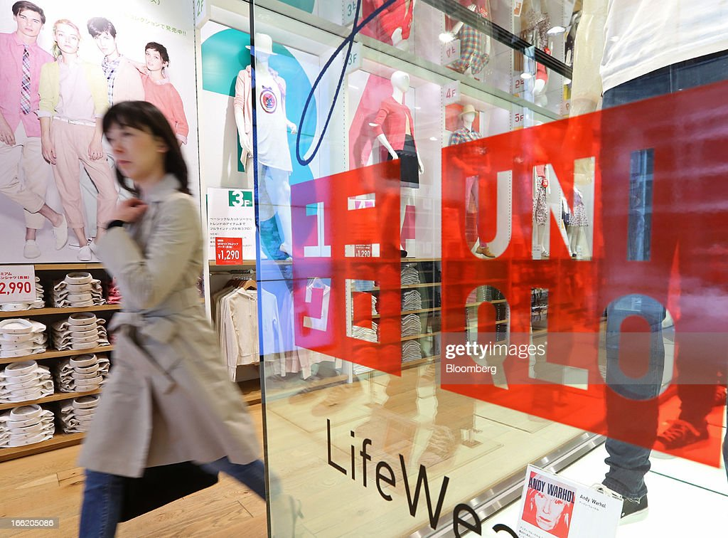 A customer walks out of Fast Retailing Co.'s Uniqlo store in the Ginza district of Tokyo, Japan, on Wednesday, April 10, 2013. Fast Retailing, Asia's largest apparel retailer, is scheduled to announce earnings tomorrow. Photographer: Yuriko Nakao/Bloomberg via Getty Images