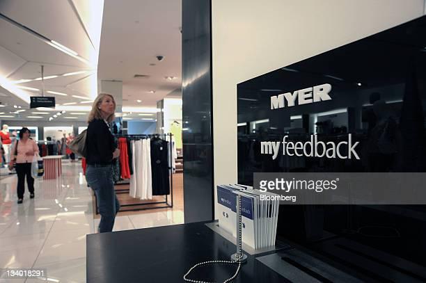 Customer walks past a feedback station in the Myer Holdings Ltd. Melbourne City store in Melbourne, Australia, on Thursday, Nov. 24, 2011. Myer...