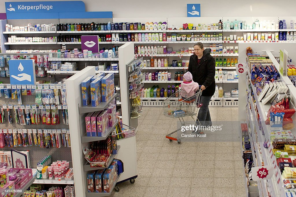 A customer walks past shelves at a Schlecker drugstore on March 16, 2012 in Strausberg, Germany. The German drugstore chain released a list of 2,010 stores in Germany that it will close out of a total of 5,400, which is less than originally predicted. Schlecker hopes to return to profitability with modern, well-placed stores like the one in Strausberg, which is not slated for closure.
