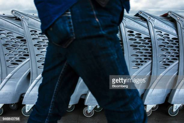 A customer walks past shopping carts parked outside a Pick n Pay Stores Ltd supermarket in Johannesburg South Africa on Monday April 9 2018 As trade...
