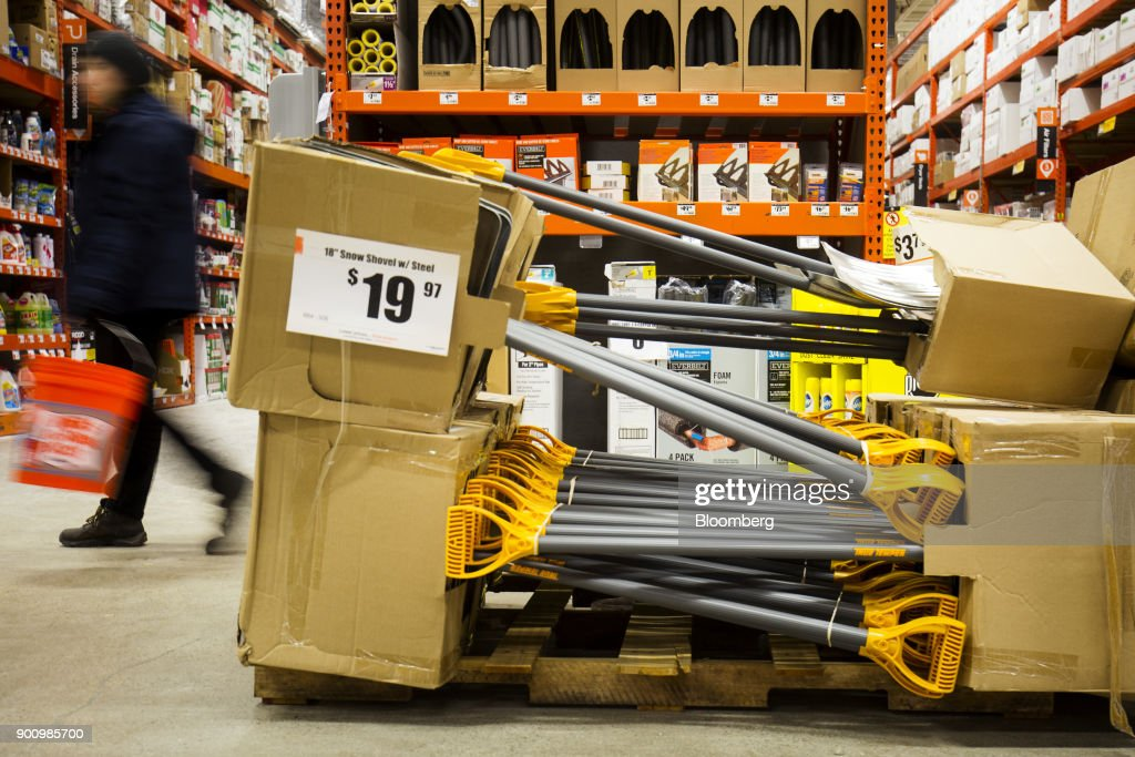 A customer walks past snow shovels on display for sale at a Home Depot Inc. store in Boston, Massachusetts, U.S., on Wednesday, Jan. 3, 2018. The worst winter storm of the season has already knocked out power and canceled more than 1,600 flights. Next it threatens to bring more snow, ice and cold from Florida to Nova Scotia, including New York and Boston. Photographer: Adam Glanzman/Bloomberg via Getty Images