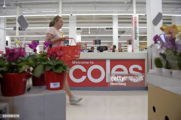 A customer walks past the customer service desk at a Coles supermarket operated by Wesfarmers Ltd in the Richmond area of Melbourne Australia on...