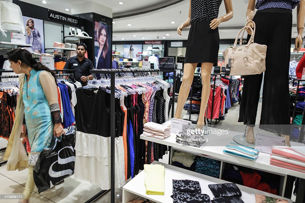 A Customer Walks Past Women S Clothing At An Austin Reed Ltd Display News Photo Getty Images